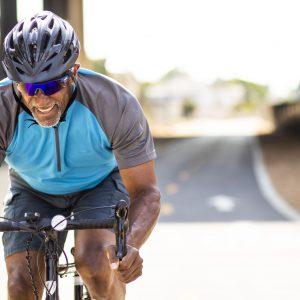 senior-black-man-racing-on-a-road-bike-royalty-free-image-1591641055